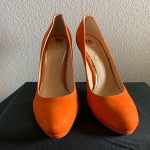 Orange leather pumps